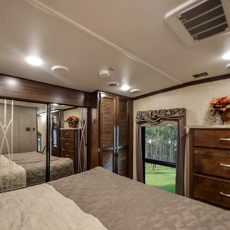 Relaxing master bedroom with a spacious closet, washer and dryer, dresser and beautiful big window.