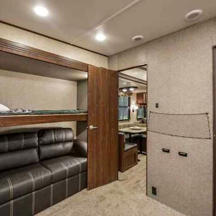 Another view of the bunk room, and half bath.