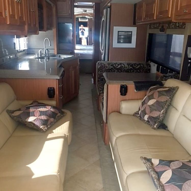 """Interior with all slides in.  There is a queen size sleeper sofa, and """"jack knife"""" bed."""