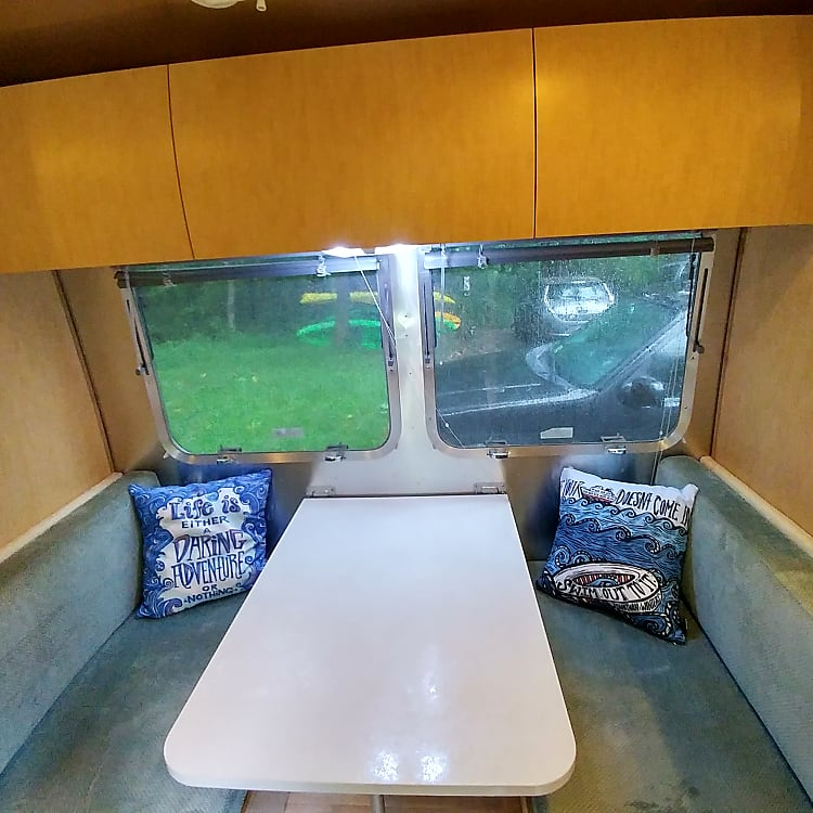 Dinette can turn into extra bed for an adult or child. The windows open very wide.