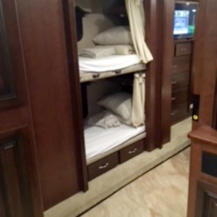 """The kids will love the DVD players in the bunks! (Ask about our kid-themed sleeping bag add-on for an even bigger """"Wow! Best vacation ever!"""" response from your kiddos.)"""