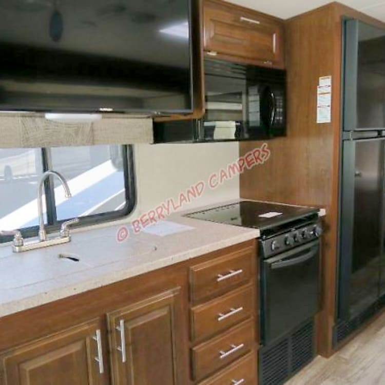 Kitchen w/ double sink, flip-up counter and two-door refrigerator