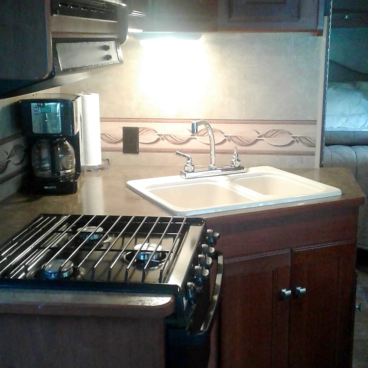 Stove w/3  and oven, Micro wave, Coffee Maker, cabinets filled with everything from Pots and pans, skillets, silverware to dishes.