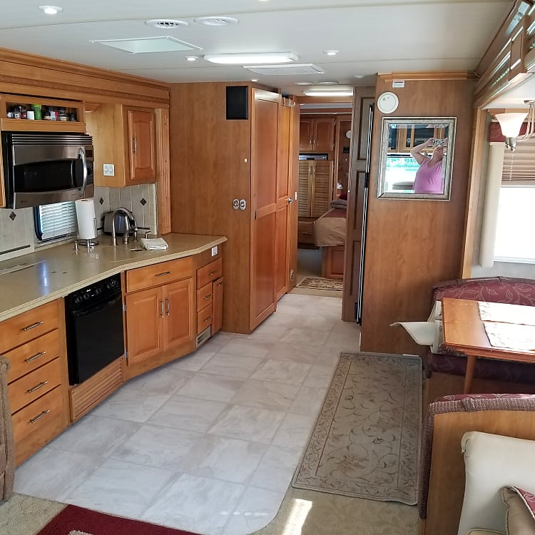 Kitchen offers stove and cooktop, and convection microwave.