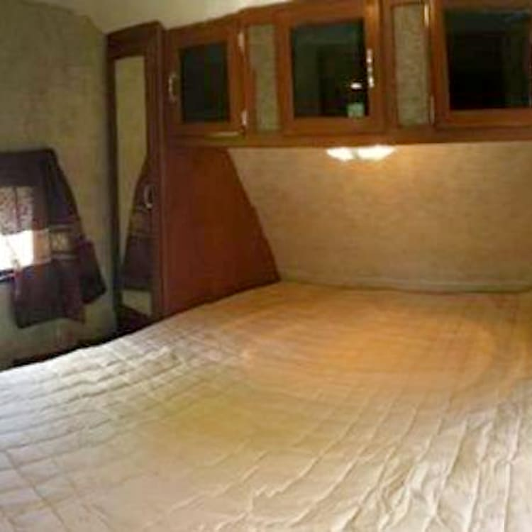 The Master bedroom!  A queen size bed with plenty of storage. Recently a LCD tv was added at the foot of the bed.