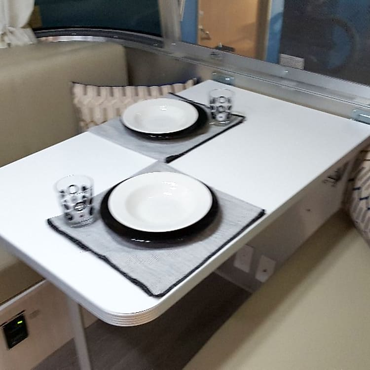 Dinette converts into bed (larger than twin, smaller than full)