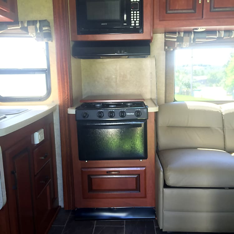 Lets start the tour with the oven, gas stovetop and microwave. There's a large pull out draw for all the pots and pans beneath the oven,