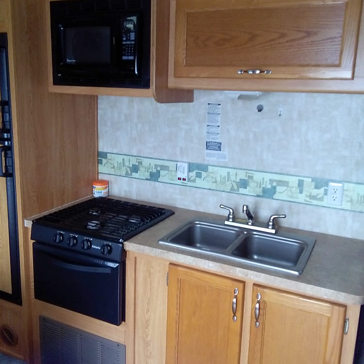 3 burners,oven, micro wave above , double sink