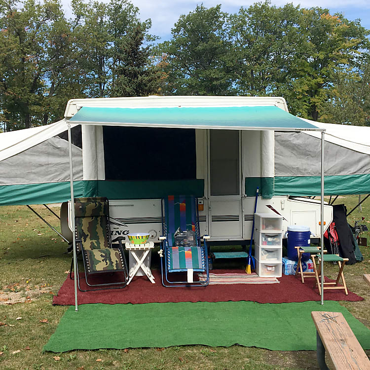 Photo showing camp set up, awning has attachable screen for an additional room.