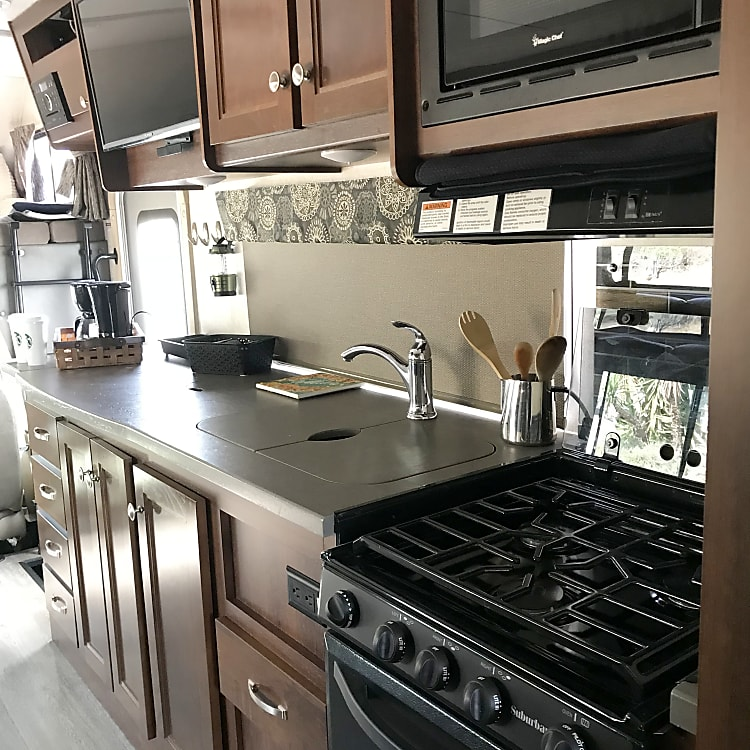 Check out this kitchen!!!! The black out kitchen panel is great when it's warm or at night when you are making cocktails.