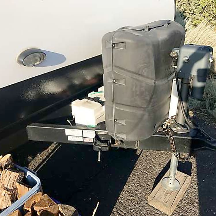 Two propane tanks and two marine grade batteries.