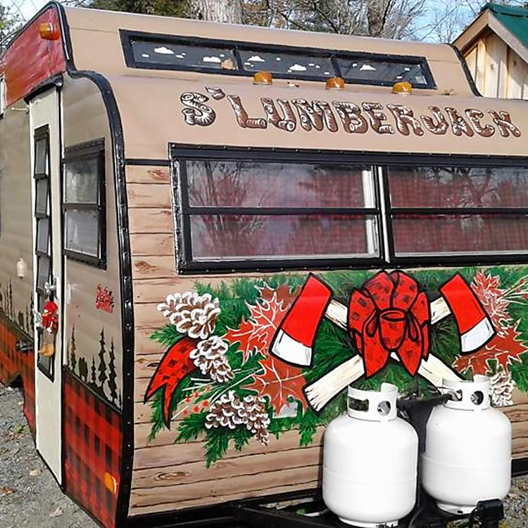The S'lumberjack is decorated throughout with an Adirondack motif.