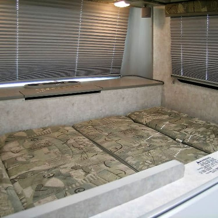 The rear dinette made down into a bed.