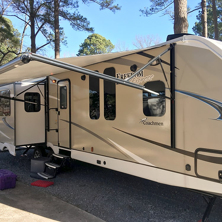Very nice looking trailer with outside shower and speakers