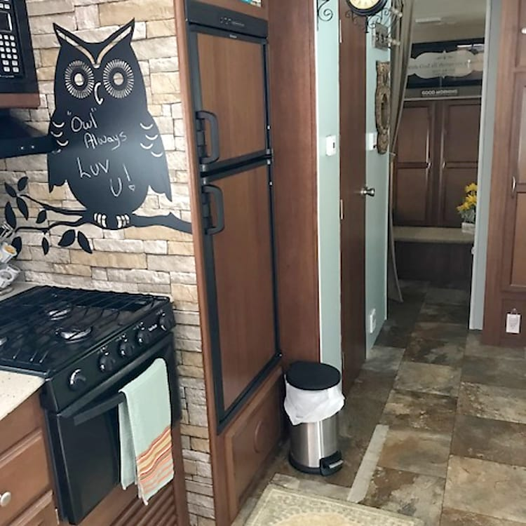 *Full kitchen with coffee maker, pots and pans, utensils and dishes, stove, oven, microwave, refrigerator/freezer