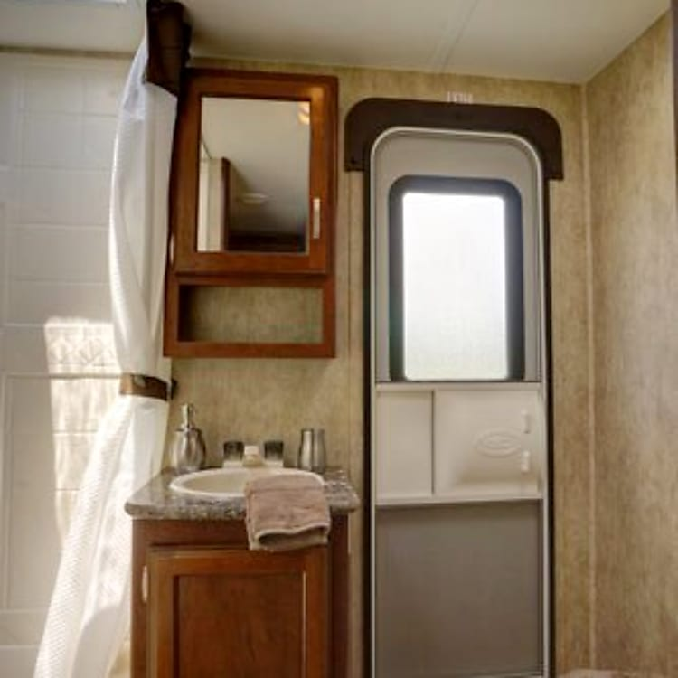 The bathroom features exterior access as well as a shower with upgraded shower head.