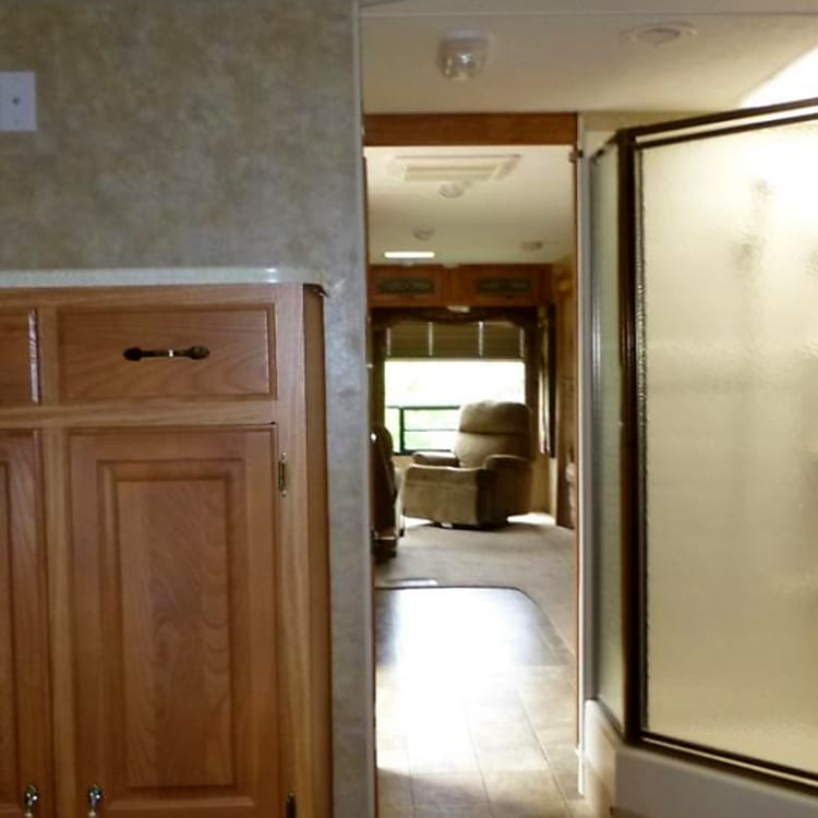 """Large hanging rod and draws.  Shower with skylight, lavatory with upper and lower storage with separate """"water closet."""""""