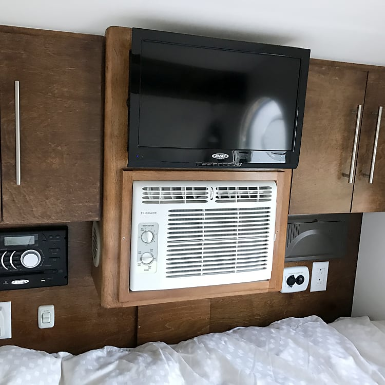 Interior entertainment center and charging station