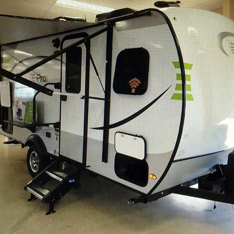 This awesome camper has an outdoor refrigerator and access to storage. There is a slide on table that holds a table top grill or a TV! We also had a bike rack installed!