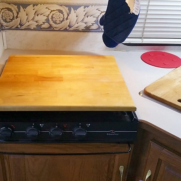 Stove and sink with cutting boards in place