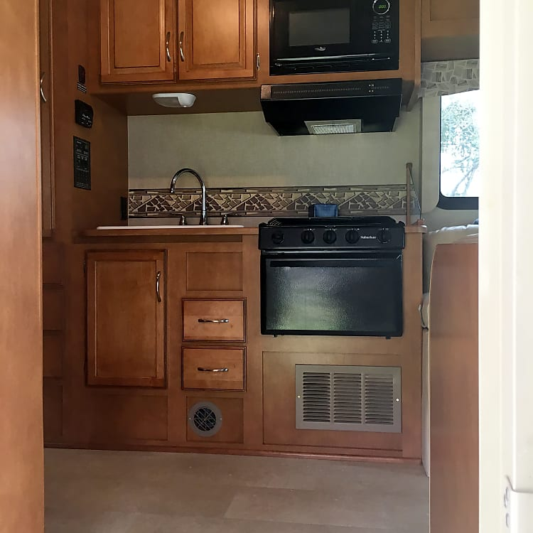 Microwave, 3 burner stove and oven.