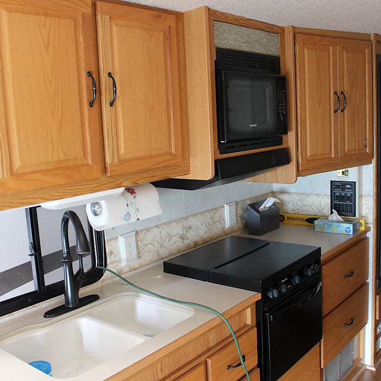 Kitchen area with nice cabinetry, pulldown faucet, propane stove and oven, refrigerator(Electric/propane)