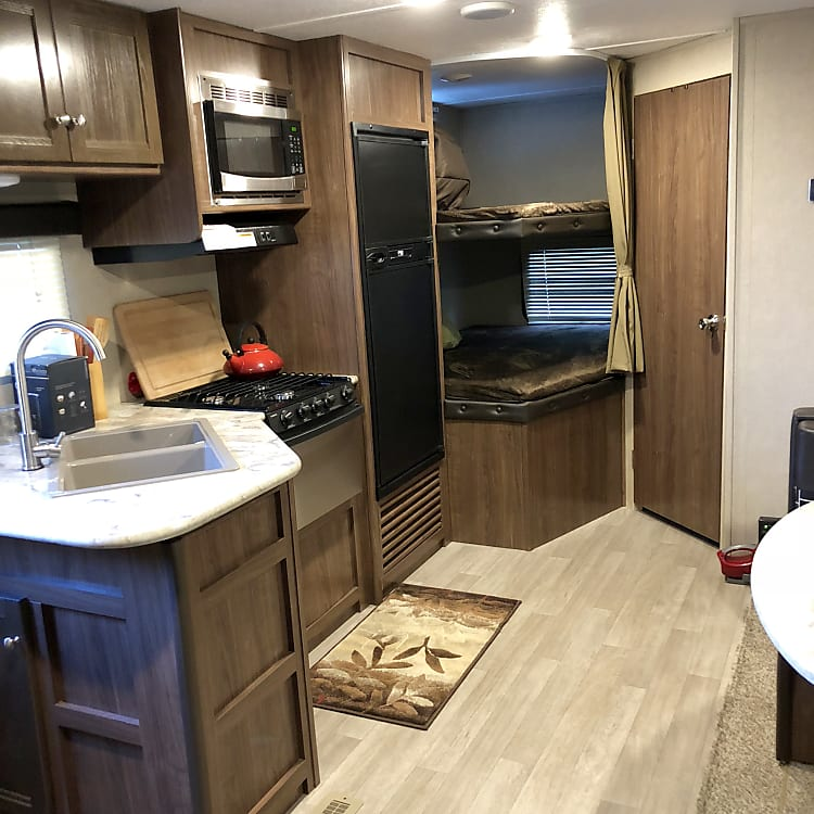 This is the common area of the trailer and bunkbeds from the perspective of the queen-bed sleeping compartment.