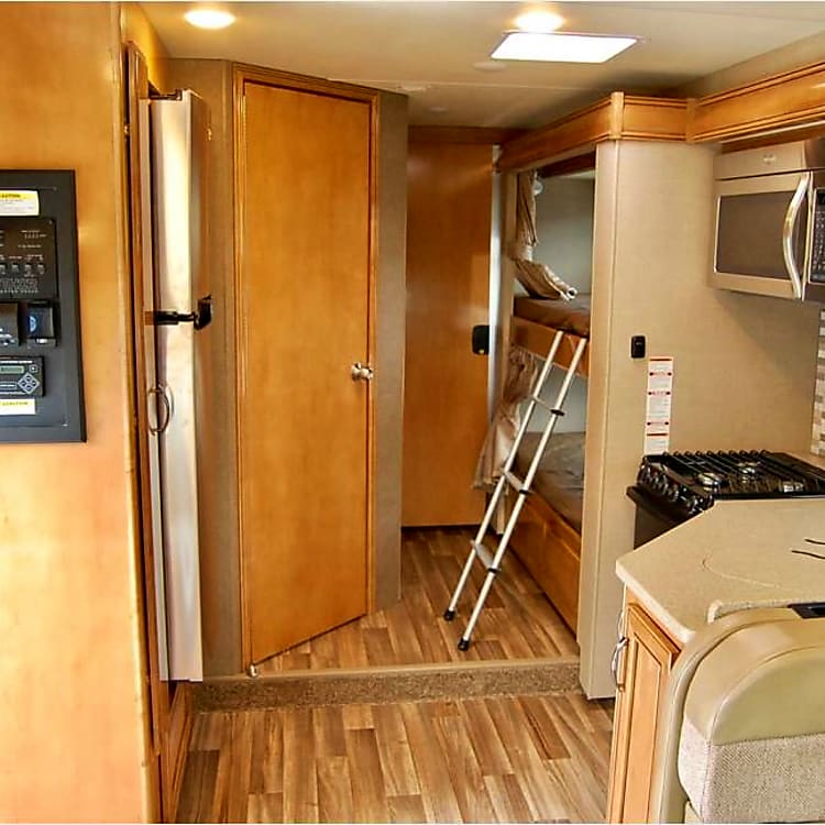 Full size fridge and bunks with TV's