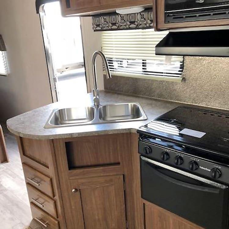 Kitchen has double sink