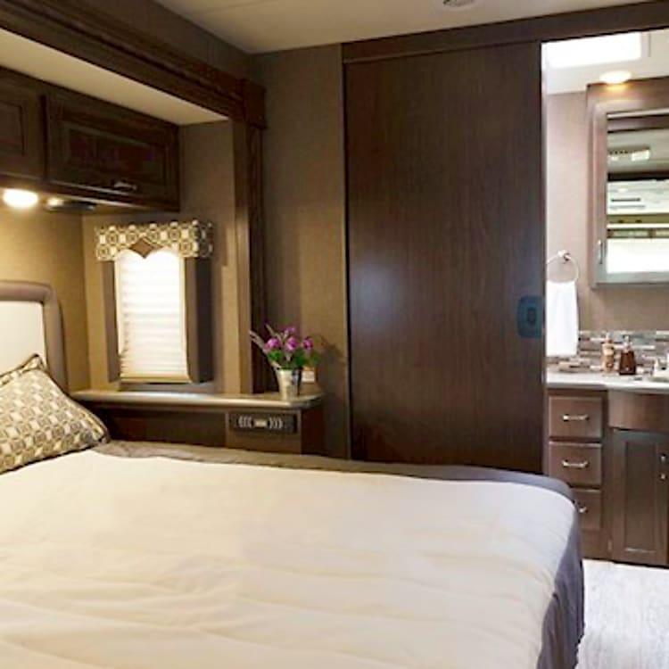 King Bedroom Suite Amazing storage. Door for privacy.