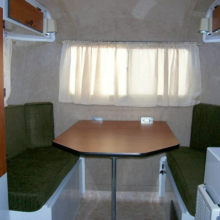 Dinette can seat 4 and folds down into a double bed