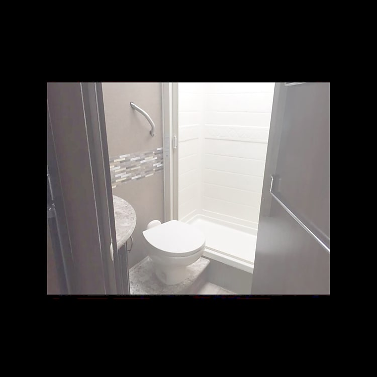 Full shower, toilet, sink, and medicine cabinet