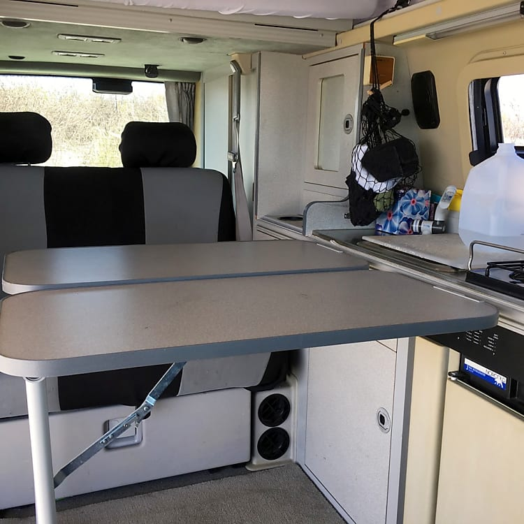 Interior features two simple-to-deploy, adjustable tables.