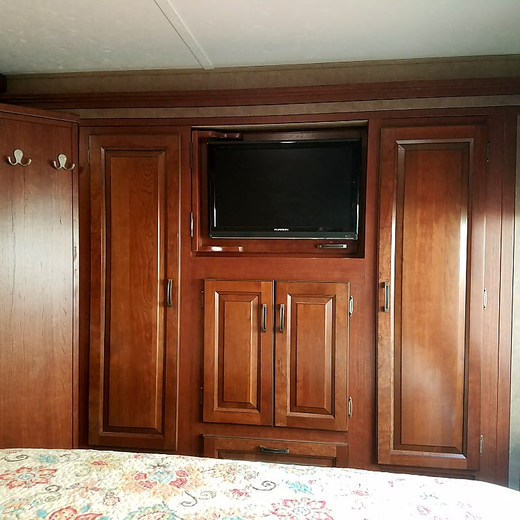 Master bedroom TV and wall storage