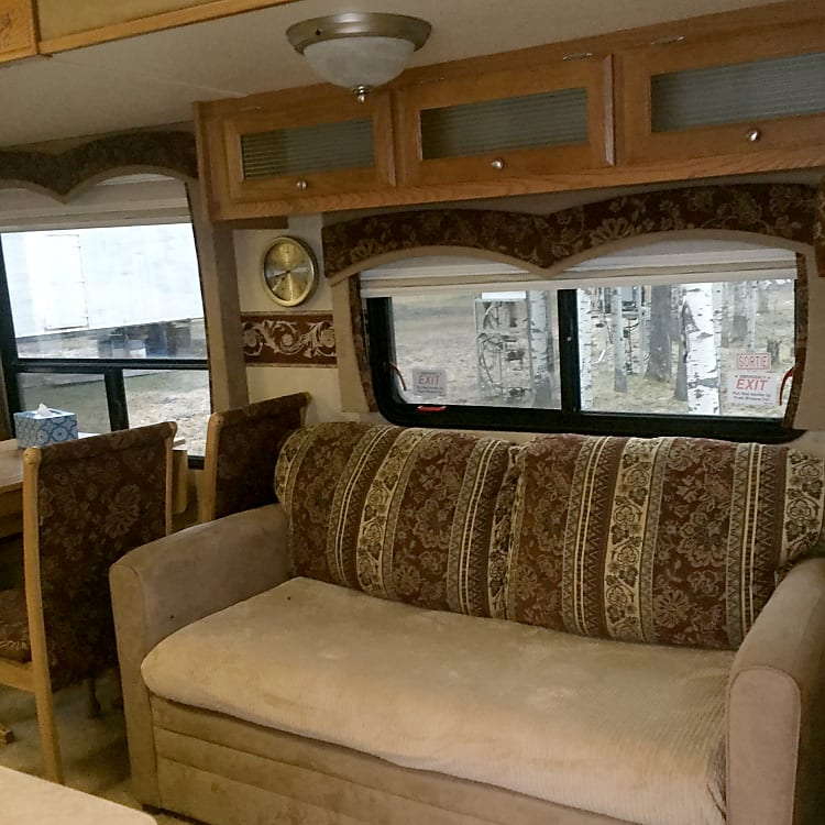 large slide out with free standing dinette and hide-a-bed