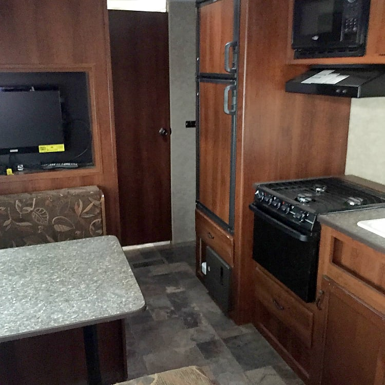 Brand spankin new appliances- top of the line stove, oven, sink, faucets, fridge/freezer. Doesn't get better than this when it comes to quality of an RV