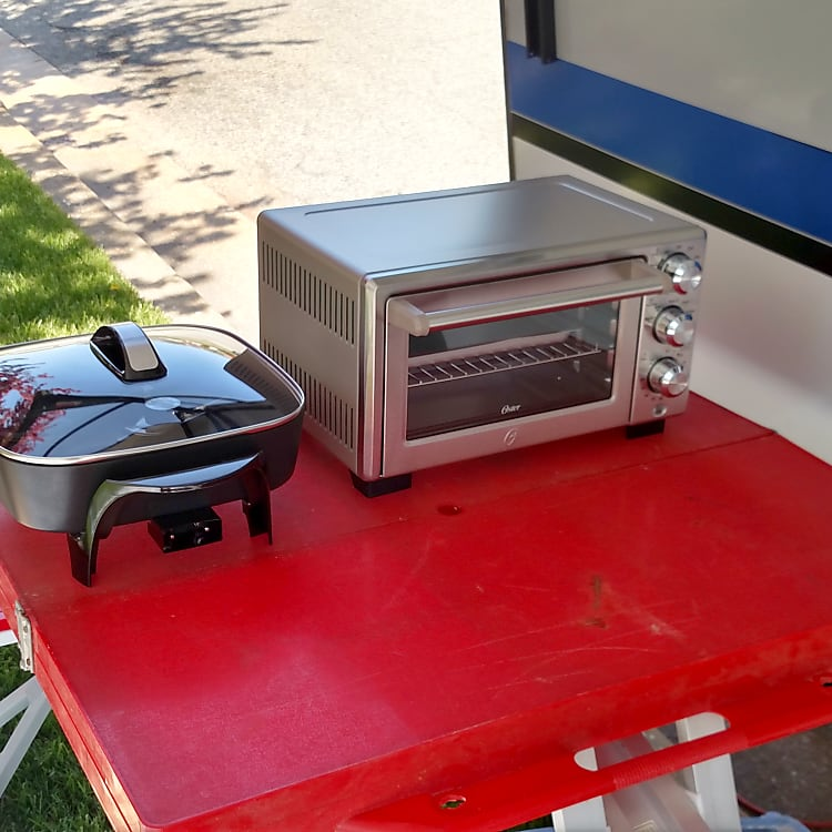 Toaster oven electric fry pan and habachi charcoal grill included allows for outdoor camp cooking. Generator available for boondocking.