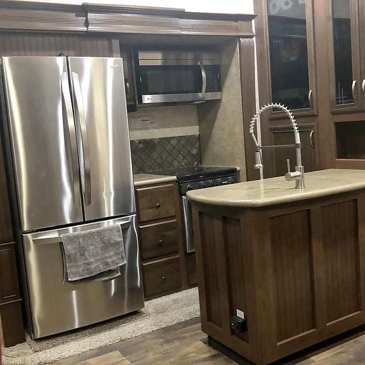 Kitchen with full size refrigerator. Comes stocked with pots,pans, silverware and an electric griddle.