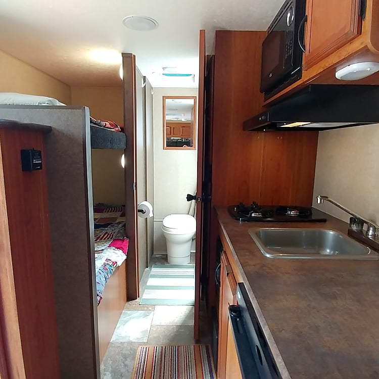 Roomy interior, clean space. Extra long bunk beds.