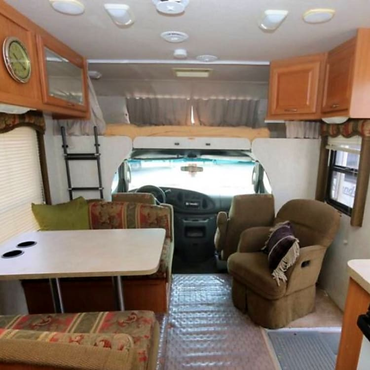 Living/dining area with view looking forward towards the cab