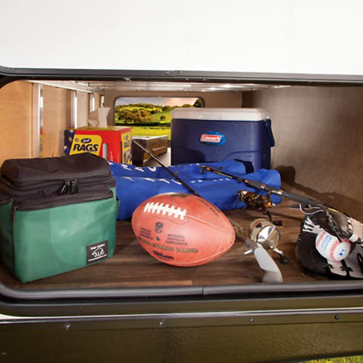 Large, pass-through, lockable storage in front accommodates your largest gear.