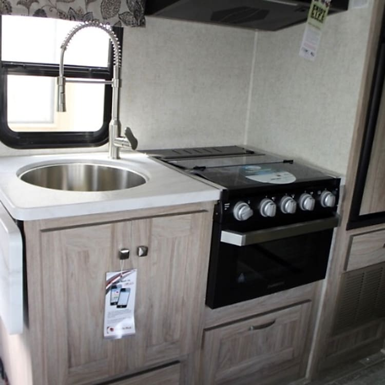 Nice kitchen area with microwave, stovetop and oven.