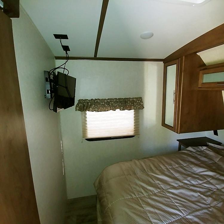 Roku TV set in bedroom