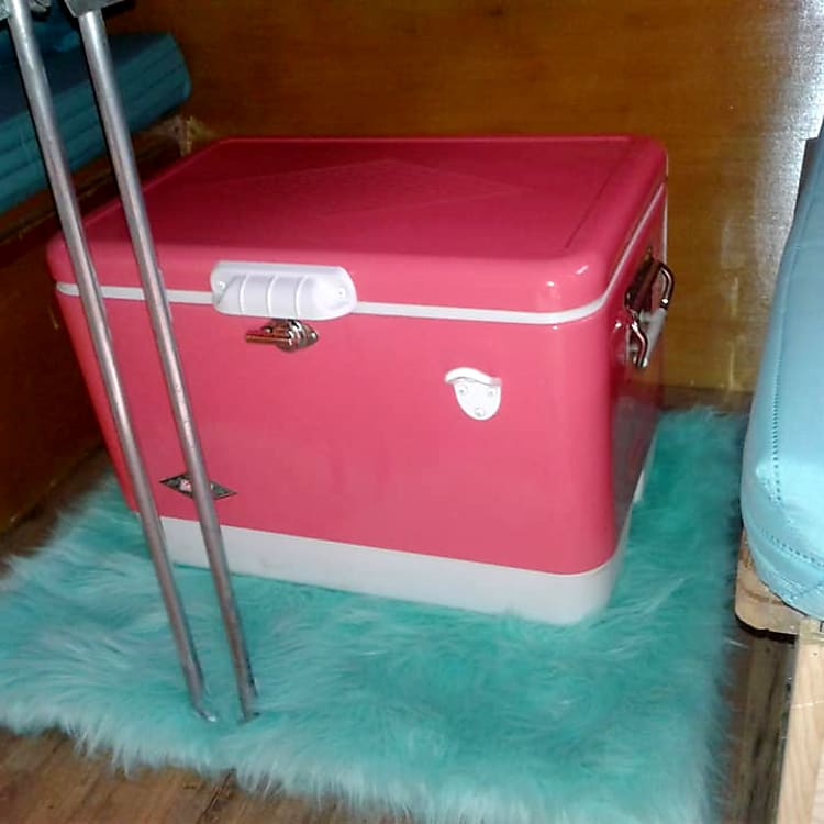 Rental includes reproduction metal fifties cooler for extra storage.