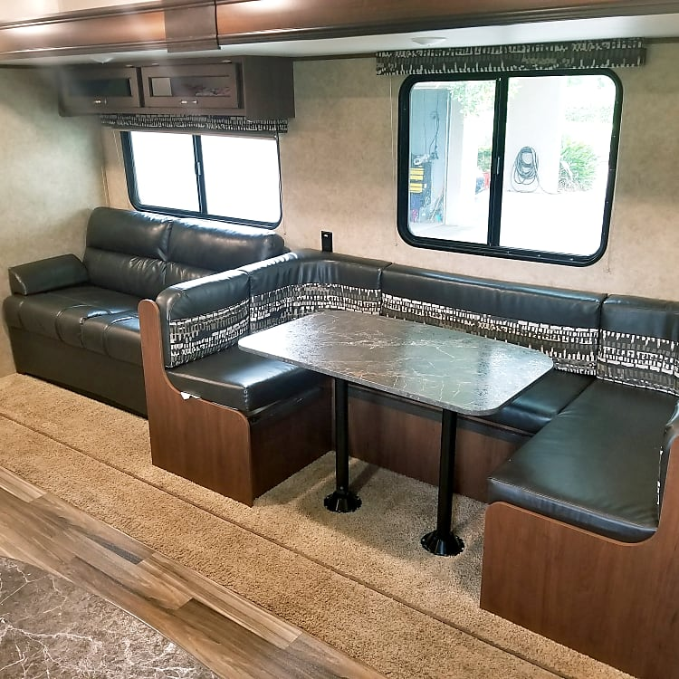 Sofa that converts to a bed, and a wrap around dinette that seats 5 comfortably. This is in addition to a bunk that features 2 full size beds, and a queen bed in the master suite.