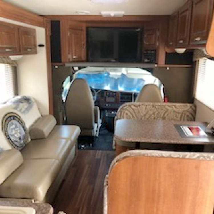 Front seating, with slide out couch/sleeper, dinette/smaller sleeper good for children, and front overhead entertainment center.