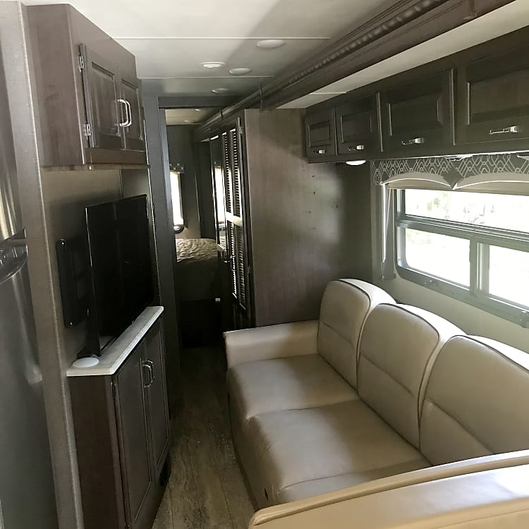 all the coach is leader with 3 TVs 2 inside 1 outside