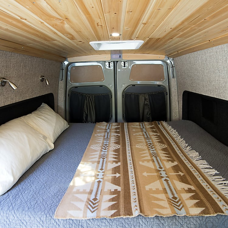 Full Queen-size Bed. Flares on both sides allow for a little extra head/leg room.