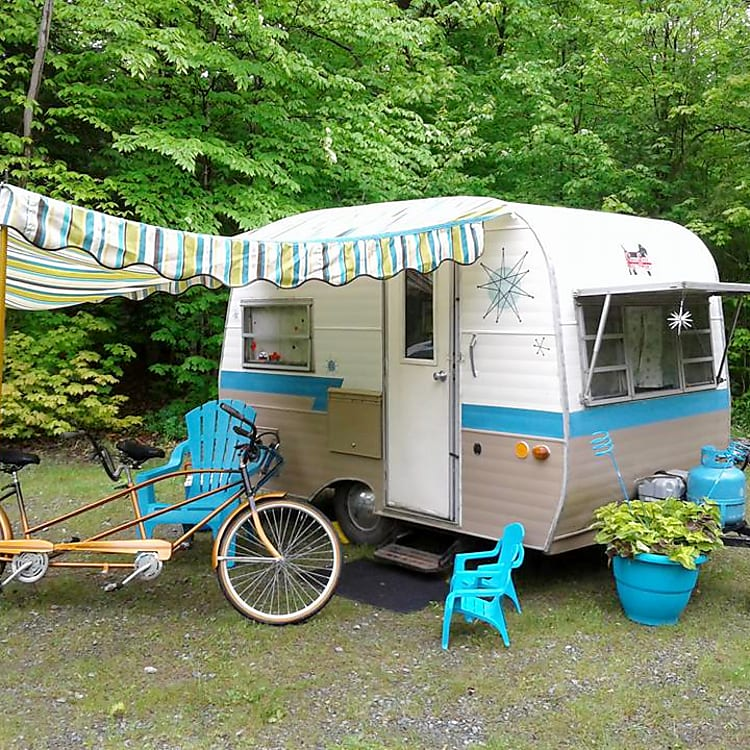 """Your """"Beam Me Up, Scotty"""" will transport you to a time gone by. Rental includes custom awning, basic supplies, simple Coleman outdoor campstove. Upgrade for additional 10 x 10 waterproof gazebo and deluxe stove/oven. Linen service available. Delivery required."""