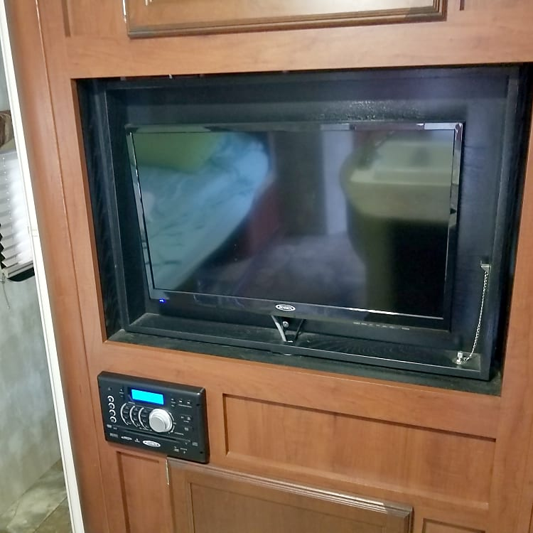 TV, DVD and Radio- Bluetooth capable!  Cable can be connected on the outside of the trailer.  TV swivels into the master suit so you can watch TV in bed.